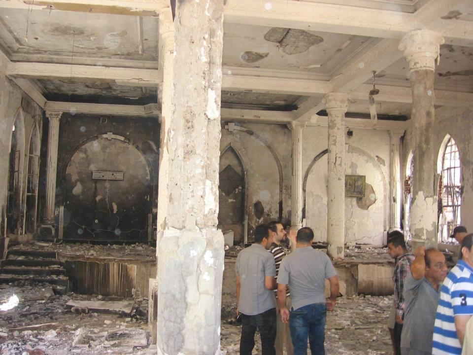 "Believers examine the damage to their church after the being destroyed by the ""non-violent and peaceful"" Muslim Brotherhood."