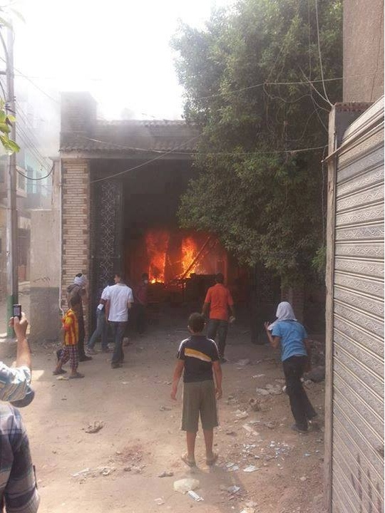 A Catholic Church burns in Elminia City, Egypt. August 14, 2013.
